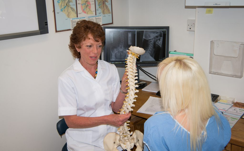 chelmsford chiropractor with patient